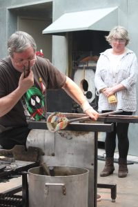 Mike and Sue Hunter demonstrating glass-making